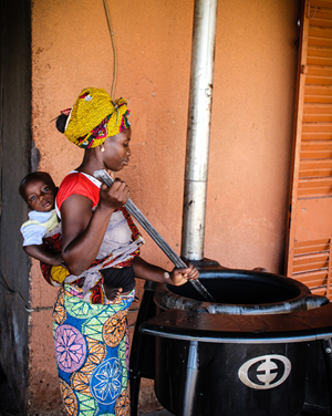 clean cooking woman with baby