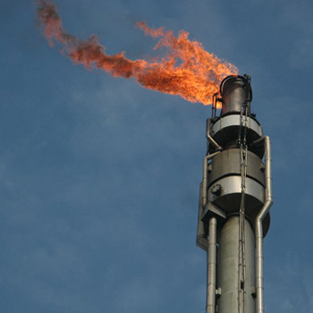 Utilization of gas flaring from oil production facilities for energy access